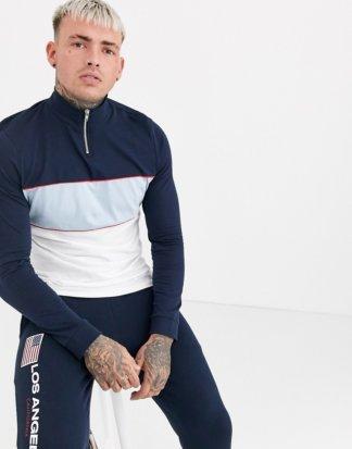 ASOS DESIGN - Langärmliges Shirt aus Bio-Material mit Reißverschluss-Stehkragen und marineblauem Farbblockdesign-Navy