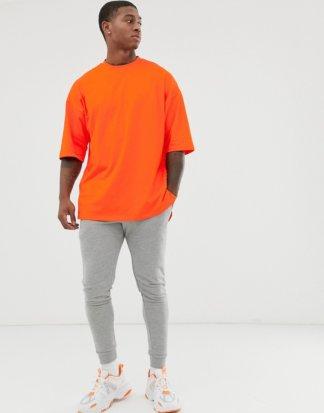 ASOS DESIGN - Orangefarbenes Oversize-T-Shirt mit Seitenschlitz