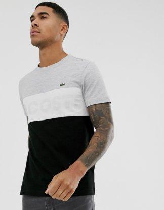 Lacoste - T-Shirt in Grau und Schwarz mit zusammengesetzten Bahnen und Brustlogo